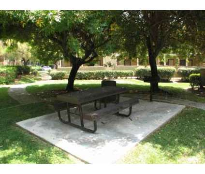 2 Beds - Woodsong at 8255 Vineyard Avenue in Rancho Cucamonga CA is a Apartment