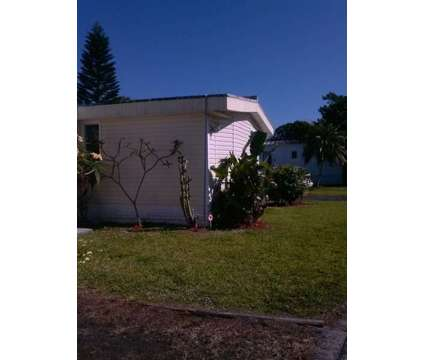3/2 + Office Doublewide On Lake In Family Community in N Fort Myers FL is a Mobile Home