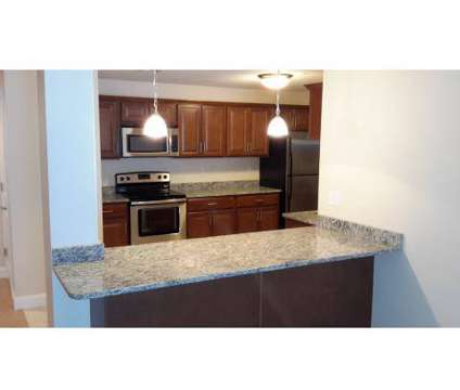 2 Beds - Grassfields Commons at 40-50 Skyline Dr in Dracut MA is a Apartment