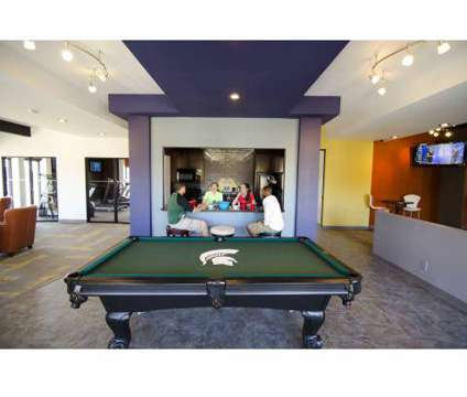3 Beds - College Towne Apartments at 4915 Belle Chase Boulevard in Lansing MI is a Apartment