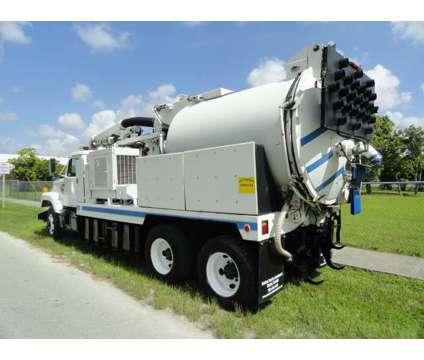1999 International F-2574 VacCon is a 1999 International Commercial Trucks & Trailer in Miami FL