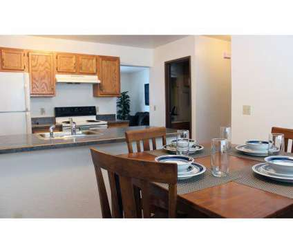3 Beds - Tallgrass Apartments & Townhomes at 1240 East Broomfield St in Mount Pleasant MI is a Apartment