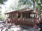 Pristine cabin in the woods with 4 additional lots.
