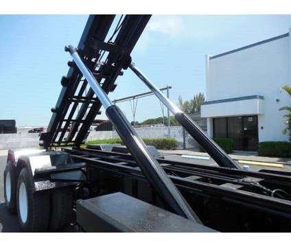 2006 Peterbilt 335 Roll Off Truck#894195 Apex Equipment is a 2006 Peterbilt 335 Model Roll Off Truck in West Palm Beach FL