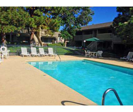 3 Beds - Sungate Apartments at 10800 Comanche Road Ne in Albuquerque NM is a Apartment