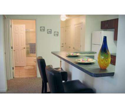 Studio - Meadowbrook Apartments & Townhomes at 2601 Dover Square in Lawrence KS is a Apartment