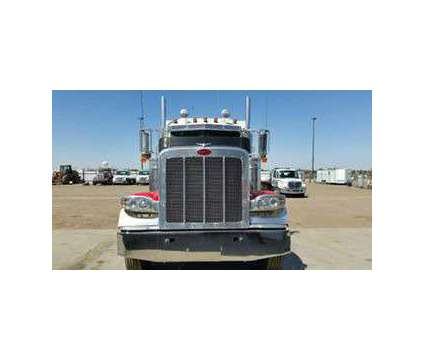 600 2012 Pete 389 with a 2015 35 ton Heavy Wrecker is a 2012 Auto Carrier Truck in Amarillo TX
