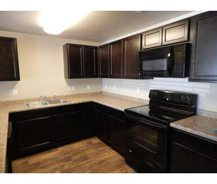 3 Beds - Oquirrh Hills at 2842 South 8440 West in Magna UT is a Apartment