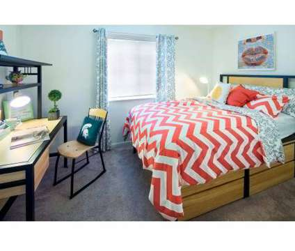 2 Beds - Campus Village at 1151 Michigan Avenue in East Lansing MI is a Apartment