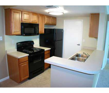 1 Bed - Desert Oasis Apartment Homes at 77-777 Country Club Drive in Palm Desert CA is a Apartment