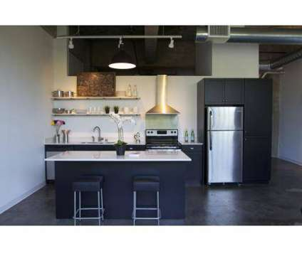 1 Bed - Junior House Lofts at 710 S 3rd St in Milwaukee WI is a Apartment