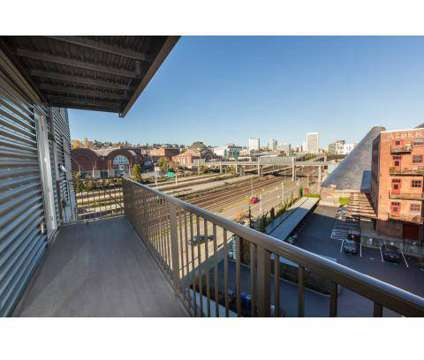 2 Beds - The Henry Apartments at 1933 Dock St in Tacoma WA is a Apartment