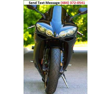 2006 Yamaha YZF-R1 is a 2006 Yamaha Super Sport Road Bike in Houston TX