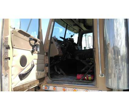 2006 Western Star 4900 Dump Truck w/like new crate engine is a 2006 Western Dump Truck in Memphis TN