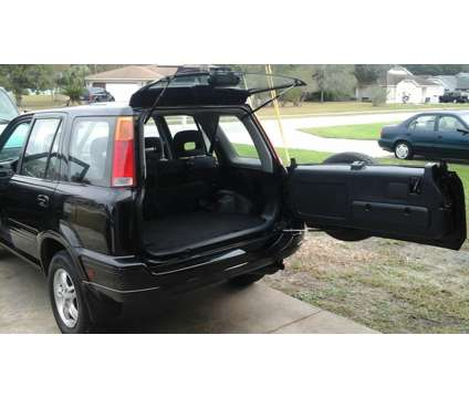 1999 Honda cr-v 4wd Ex is a 1999 Honda CR-V SUV in Spring Hill FL