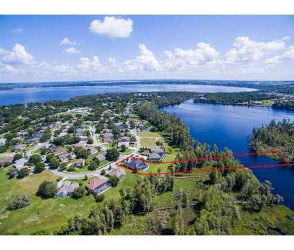 Lake Front House at 11626 Graces Way Lake Mary, FL 34711 at 11626 Graces Way Lake Mary, Fl 34711 in Lake Mary FL is a Single-Family Home