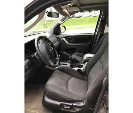 2005 Mazda Tribute is a 2005 Mazda Tribute s SUV in Roanoke VA