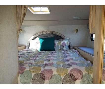 2001 Big Foot Truck Camper Model 30C10.11SL w/ Dinette Slide-out and Dry Shower is a 2001 Camper in Loveland CO