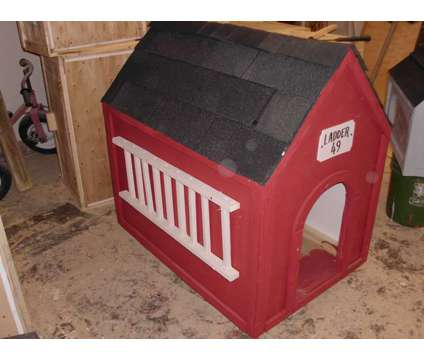 DOG HOUSE s - All different colors & sizes is a in Grand Rapids MI