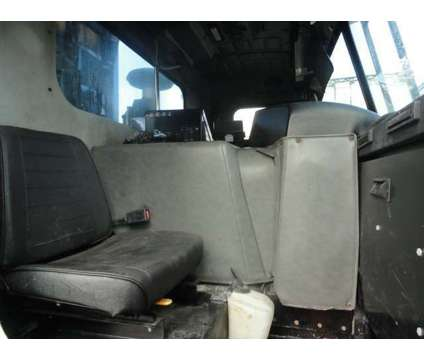 2006 Peterbilt 320 McNeilus Front Loader Garbage Truck is a 2006 Refuse Truck in Miami FL