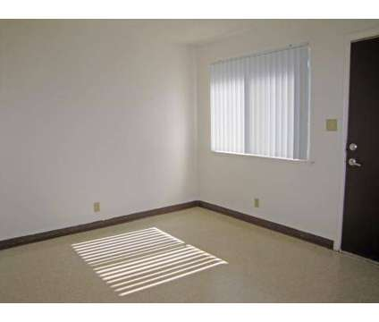 4 Beds - Bigby Villa at 1329 E Reverend Chester Riggins Avenue in Fresno CA is a Apartment