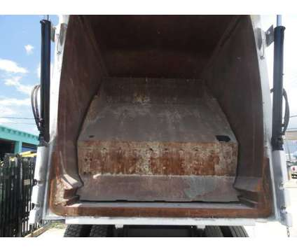 2006 Sterling Condor Kenn 41 YD Front Loader Garbage Truck is a 2006 Refuse Truck in Miami FL