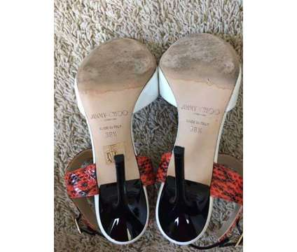 Jimmy Choo Sandals is a Black, White Shoes for Sale in Houston TX