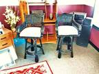 Set of black wicker stools