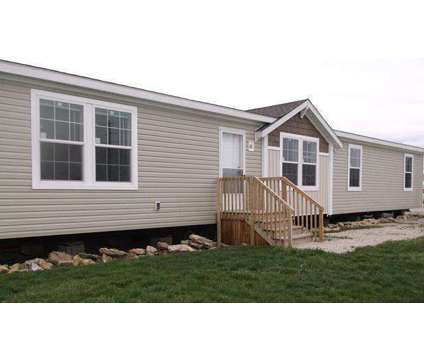 4 bedroom manufactured home ready to be delivered to your place in Dickinson ND is a Mobile Home
