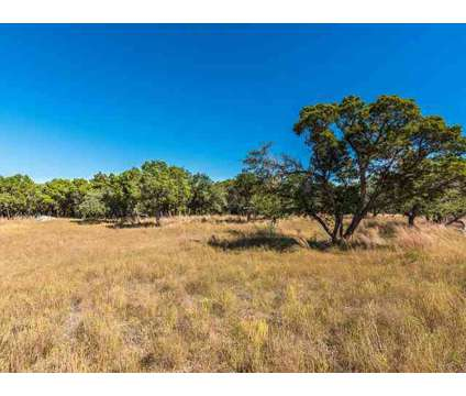 1.08 acre level lot with trees nestled at the end of a quiet cul-de-sac. at 228 Terra Scena Trl in Dripping Springs TX is a Land