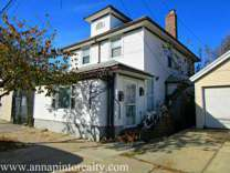2-Family House + 4 Commercial Stores FOR SALE