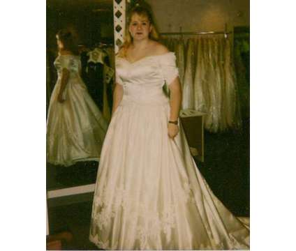 White Beautiful Wedding Dress by Demetnos-Never worn is a White Wedding Dresses for Sale in Chicago IL
