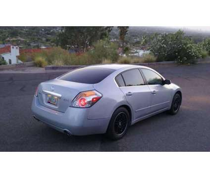 Altima 2007 Nissan 168k Miles 2.5 Automatic Silver with Grey Interior is a Grey, Silver 2007 Car for Sale in Phoenix AZ