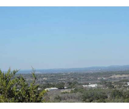 Beautiful treed 10.54 acre tract with hill top, numerous building sites and at 7 Gregg Dr in Spicewood TX is a Real Estate and Homes