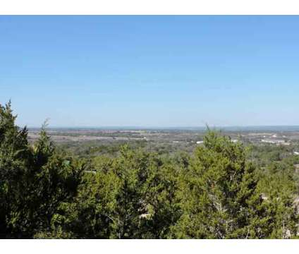 Beautiful treed 10.54 acre tract with hill top, numerous building sites and at 7 Gregg Dr in Spicewood TX is a Land