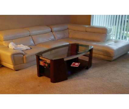 White Leather Sectional & Glass Coffee Table is a White Sofas for Sale in Houston TX