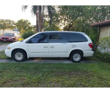 2002 Chrysler Town and Country is a 2002 Chrysler town & country Mini-Van in Cutler Bay FL