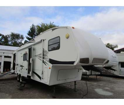 2008 35ft Keystone Cougar Toy Hauler w/slide out is a 2008 Keystone Cougar Camper in Bunker Hill IL
