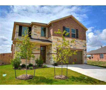 Beautiful stone and brick two-story home built by Meritage Homes. at 120 Kavanaugh St in Georgetown TX is a Single-Family Home