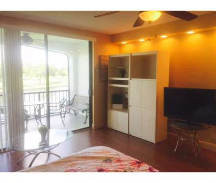 Fully Furnished Studio Directly on the Lake (Great View) at 3760 Inverrary Drive in Lauderhill FL is a Apartment