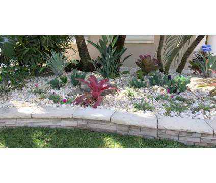 Pink and Green Landscaping Services is a Landscaping service in Hollywood FL