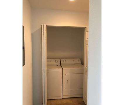 2/2 Downtown Condo w/ BRAND NEW FLOORING at 1064 N Tamiami Tr in Sarasota FL is a Condo