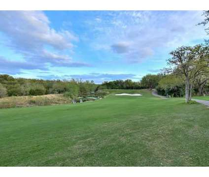 A vacation every day! Totally renovated condo on the golf course within the at 1 Crystal Springs Ct in The Hills TX is a Condo
