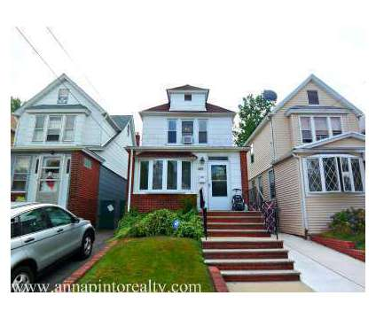 68-38 Kessel St., Forest Hills, NY in Forest Hills NY is a Single-Family Home