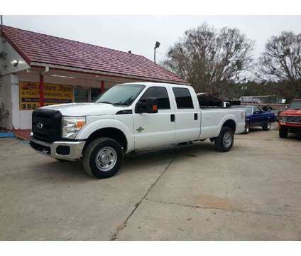 2011 Ford F-250 Super Duty XLT 4x4 4dr Crew Cab 8 ft. LB Pickup is a 2011 Ford F-250 Super Duty Truck in Ocala FL