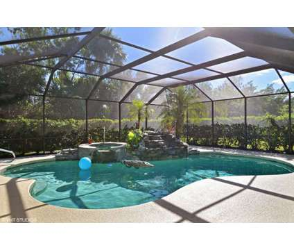 Private Oasis in PGA Village at 7931 Plantation Lake Dr in Port Saint Lucie FL is a Single-Family Home