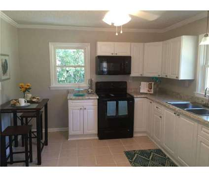 LEASE TO OWN (No Financing) Renovated Decatur Bungalow at 2381 Ousley Court in Decatur GA is a Single-Family Home