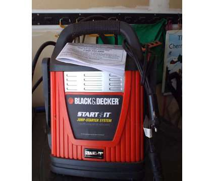 Battery Charger is a Black Car Electronics for Sale in Kalamazoo MI