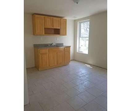 Fully Renovated Bright 3 Bedroom Apt.. Over Looking THE-PARK * at 447 Jackson Ave Brom in Richmond Hill NY is a Apartment