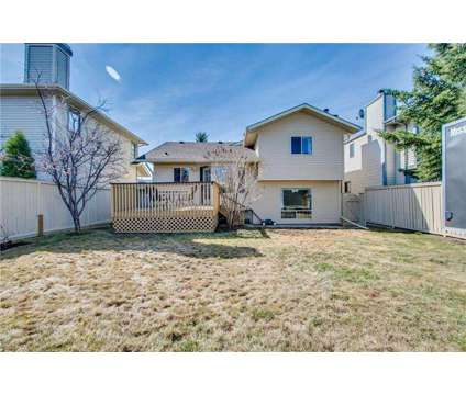 Charming home full of character in Woodbine at 148 Woodmark Crescent Sw in Calgary AB is a House